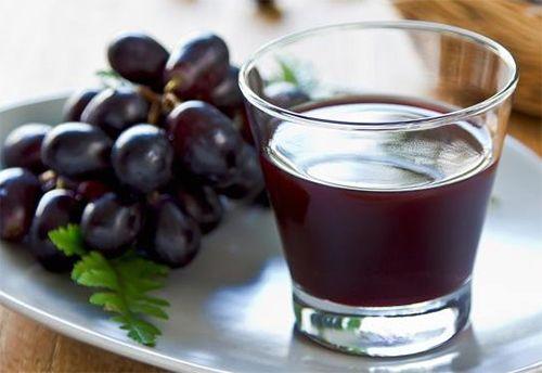 benefícios do suco de uva integral